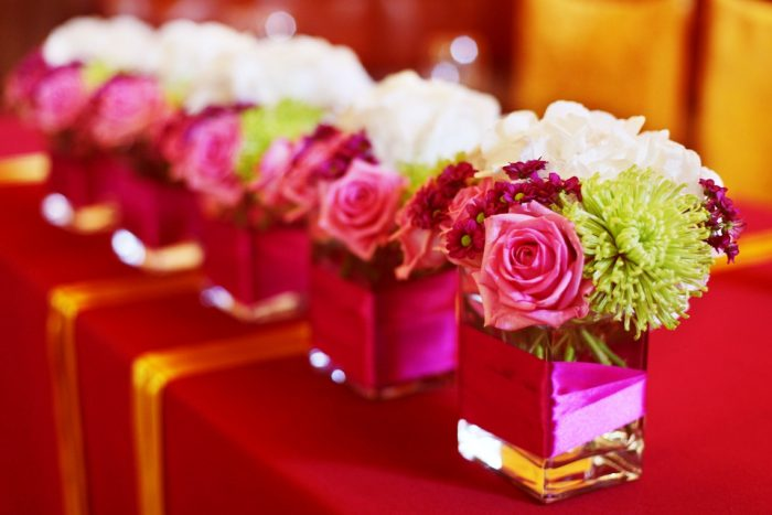 bouquets of roses on the tables